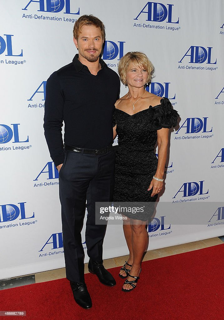Actor Kellan Lutz and his mother Karla Pope arrive at the Anti-Defamation League entertainment industry dinner honoring Roma Downey and Mark Burnett at The Beverly Hilton Hotel on May 8, 2014 in Beverly Hills, California.