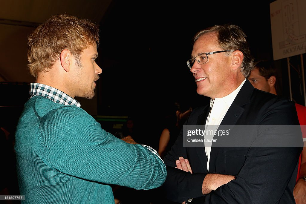 Actor Kellan Lutz and Lacoste CEO Steve Birkhold pose backstage at the Lacoste Spring 2013 fashion show during Mercedes-Benz Fashion Week at The Theatre, Lincoln Center on September 8, 2012 in New York City.