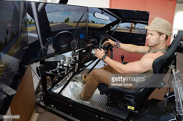 Actor Kellan Lutz practices on a driving simulator at Oakley Learn To Ride With O'Gara Coach Bentley Beverly Hills and Bentley Westlake At Thermal...