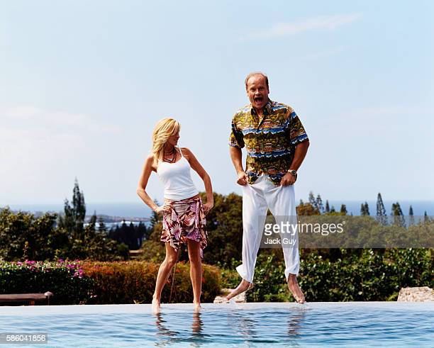 Kelsey Grammer and his wife Camille wade in the 'infinity pool' at their Maui home