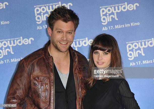Actor Ken Duken and actress Felicity Jones attend the 'Powder Girl' photocall at the Charles Hotel on March 4 2011 in Munich Germany