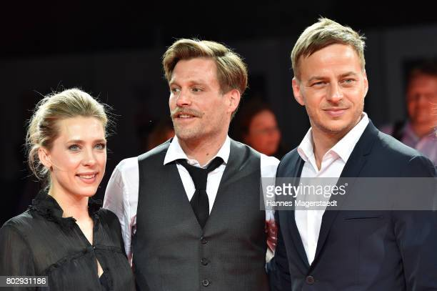 Actor Ken Duken his wife Marisa Leonie Bach and Tom Wlaschiha attend the 'Berlin Falling' Premiere during Munich Film Festival 2017 at Gasteig on...