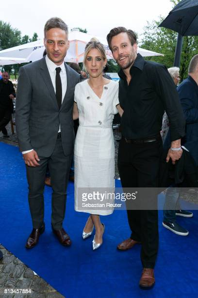 Actor Ken Duken his wife Marisa Leonie Bach and Tom Wlaschiha attend the summer party 2017 of the German Producers Alliance on July 12 20l7 in Berlin...