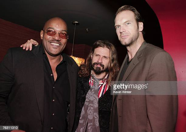 Actor Ken Foree writer/director Rob Zombie and actor Tyler Mane pose at the afterparty for the premiere of MGM's 'Halloween' at the Geisha House on...