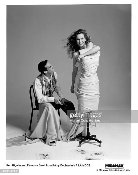 Actor Ken Higelin and actress Florence Darel pose on set of the movie 'A la mode' circa 1993