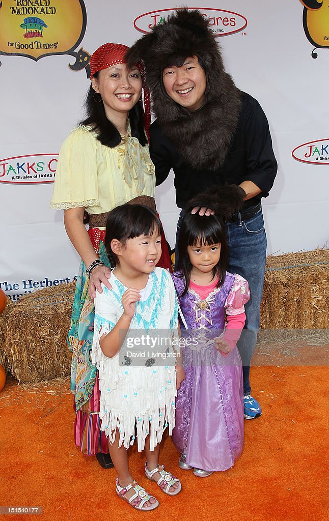 Actor <a gi-track='captionPersonalityLinkClicked' href=/galleries/search?phrase=Ken+Jeong&family=editorial&specificpeople=4195975 ng-click='$event.stopPropagation()'>Ken Jeong</a> (R) and family attend Camp Ronald McDonald for Good Times 20th Annual Halloween Carnival at the Universal Studios Backlot on October 21, 2012 in Universal City, California.