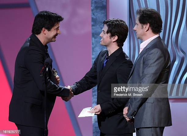 Actor Ken Marino accepts the award for Best Male Performance from presenters Jackson Rathbone and Jamie Kennedy onstage at the 3rd Annual Streamy...