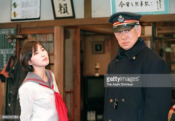 Actor Ken Takakura and actress Ryoko Hirosuke are seen filing movie 'Poppoya' on March 18 1999 in Tokyo Japan