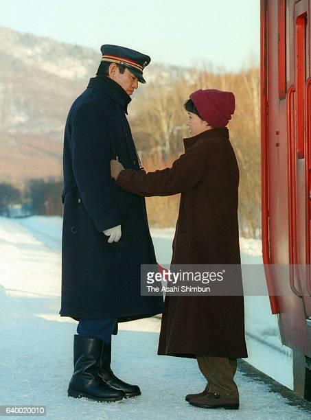 Actor Ken Takakura and actress Shinobu Otake are seen at the 'Poppoya' location on January 24 1999 in Minamifurano Hokkaido Japan