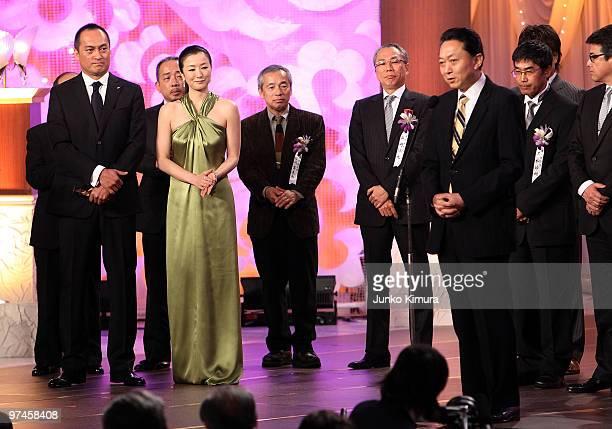 Actor Ken Watanabe actress Kyoka Suzuki and Japanese Prime Minister Yukio Hatoyama attend the 33rd Japan Academy Aawrds at Grand Prince Hotel New...