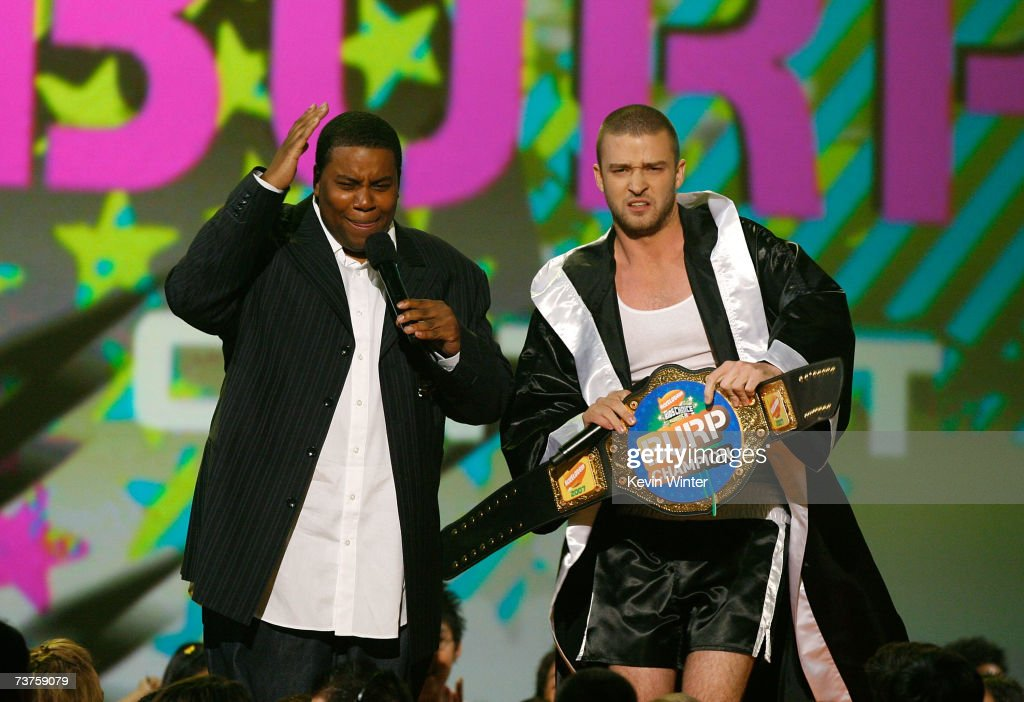 Actor Kenan Thompson and host Justin Timberlake speak onstage during the 20th Annual Kid's Choice Awards held at the UCLA Pauley Pavilion on March 31...