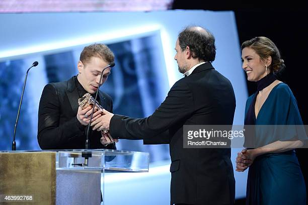 Actor Kevin Azais receives from Denis Podalydes and Julie Gayet the award for Most Promising Actor during the 40th Cesar Film Awards 2015 Ceremony at...