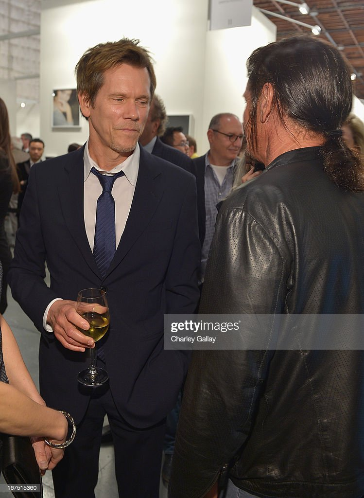 Actor <a gi-track='captionPersonalityLinkClicked' href=/galleries/search?phrase=Kevin+Bacon&family=editorial&specificpeople=202000 ng-click='$event.stopPropagation()'>Kevin Bacon</a> (L) and Founder, Chief Executive Officer and Chairman of the Board of J/P Haitian Relief Organization <a gi-track='captionPersonalityLinkClicked' href=/galleries/search?phrase=Sean+Penn&family=editorial&specificpeople=202979 ng-click='$event.stopPropagation()'>Sean Penn</a> attend Giorgio Armani Paris Photo LA Acqua #3 at Paramount Studios on April 25, 2013 in Los Angeles, California.