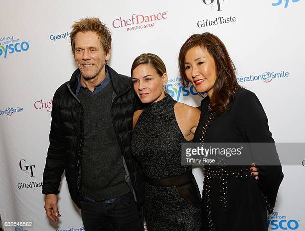 Actor Kevin Bacon chef Cat Cora and host Mimi Kim attend ChefDance and Operation Smile on January 23 2017 in Park City Utah