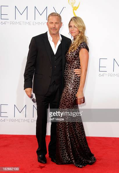 Actor Kevin Costner and Christine Baumgartner arrive at the 64th Primetime Emmy Awards at Nokia Theatre LA Live on September 23 2012 in Los Angeles...