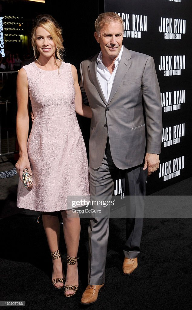 Actor Kevin Costner and Christine Baumgartner arrive at the Los Angeles premiere of 'Jack Ryan: Shadow Recruit' at TCL Chinese Theatre on January 15, 2014 in Hollywood, California.