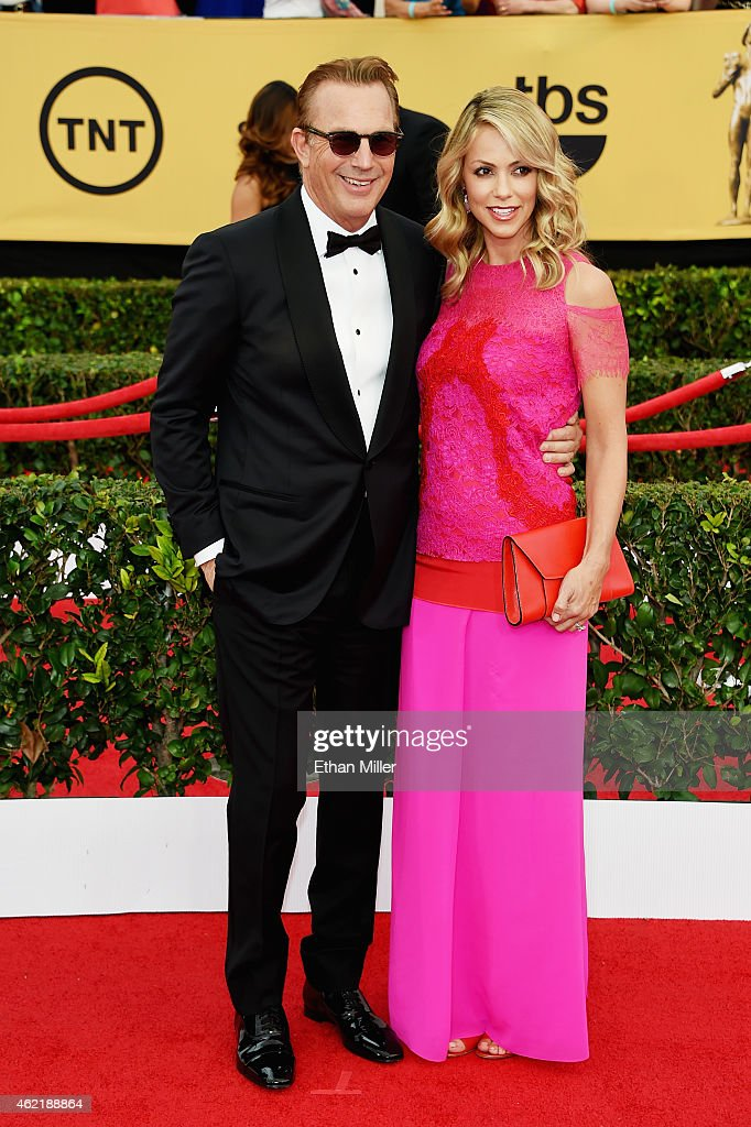Actor Kevin Costner and Christine Baumgartner attend the 21st Annual Screen Actors Guild Awards at The Shrine Auditorium on January 25 2015 in Los...