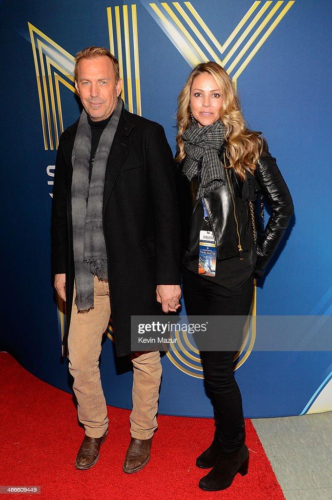 Actor Kevin Costner and Christine Baumgartner attend the Pepsi Super Bowl XLVIII Pregame Show at MetLife Stadium on February 2 2014 in East...