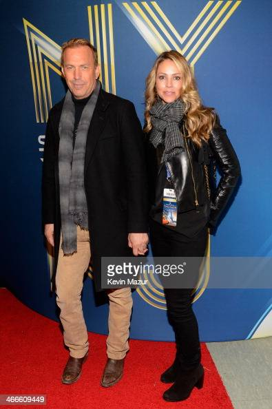 Actor Kevin Costner and Christine Baumgartner attend the Pepsi Super Bowl XLVIII Pregame Show at MetLife Stadium on February 2 2014 in East...