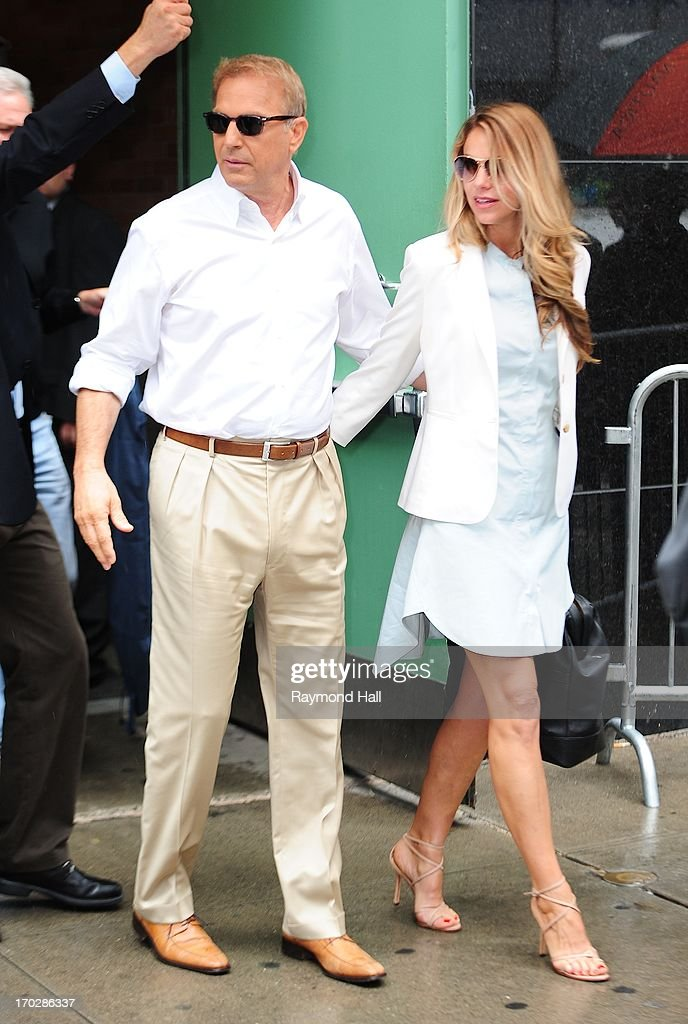 Actor Kevin Costner and Christine Baumgartner is seen outside 'Good Morning America' in Times Square on June 10, 2013 in New York City.