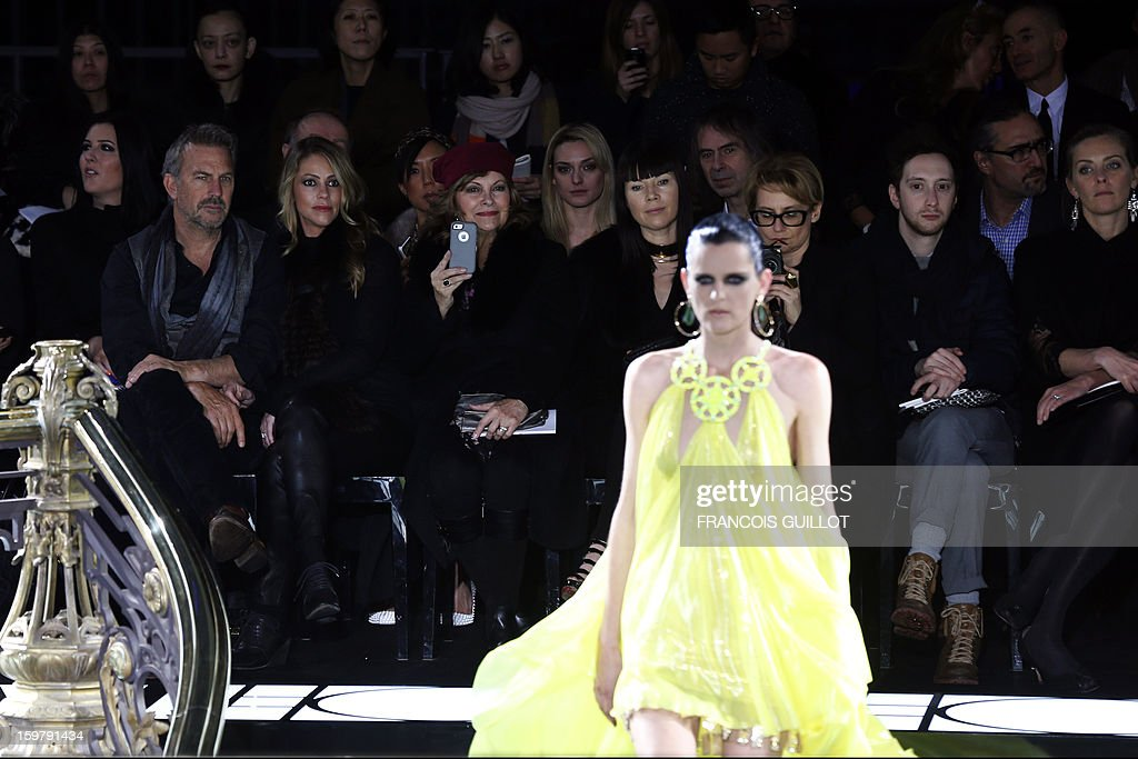 US actor Kevin Costner (L) and his wife Christine (2ndL) attend the Haute Couture Spring-Summer 2013 Versace collection show, on January 20, 2013 in Paris. AFP PHOTO / FRANCOIS GUILLOT