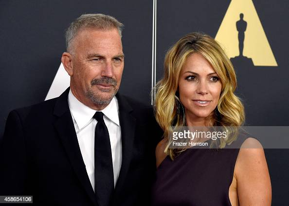 Actor Kevin Costner and model Christine Baumgartner attend the Academy Of Motion Picture Arts And Sciences' 2014 Governors Awards at The Ray Dolby...