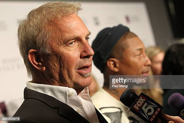 Actor Kevin Costner and Pharrell Williams talk with the media at the 'Hidden Figures' Washington DC Screening at National Museum of African American...