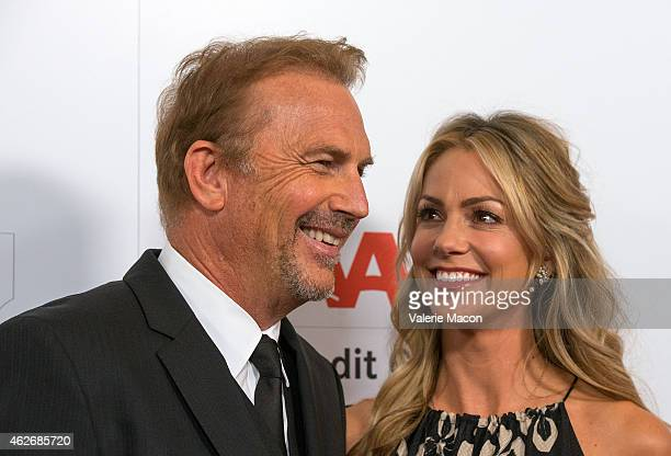Actor Kevin Costner and wife Christine Baumgartner arrive at the AARP The Magazine's 14th Annual Movies For Grownups Awards Gala at the Beverly...
