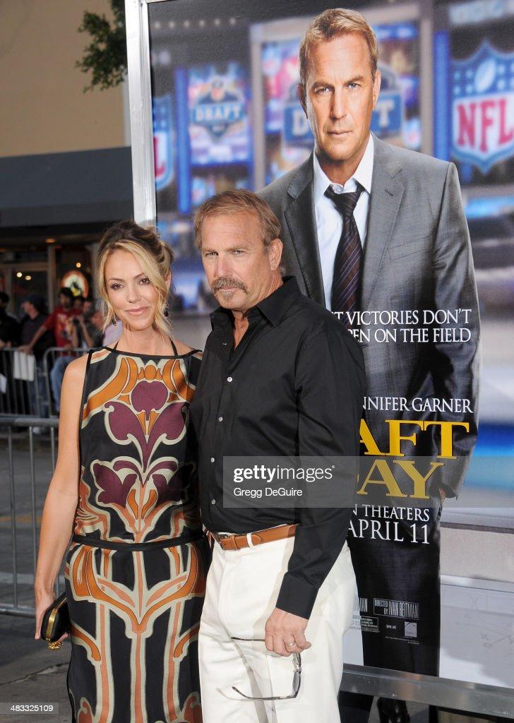 Actor Kevin Costner and wife Christine Baumgartner arrive at the Los Angeles premiere of 'Draft Day' at Regency Village Theatre on April 7 2014 in...