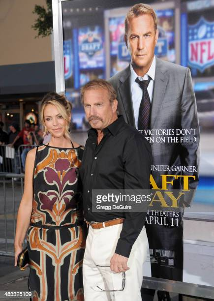Actor Kevin Costner and wife Christine Baumgartner arrive at the Los Angeles premiere of 'Draft Day' at Regency Village Theatre on April 7 2014 in...