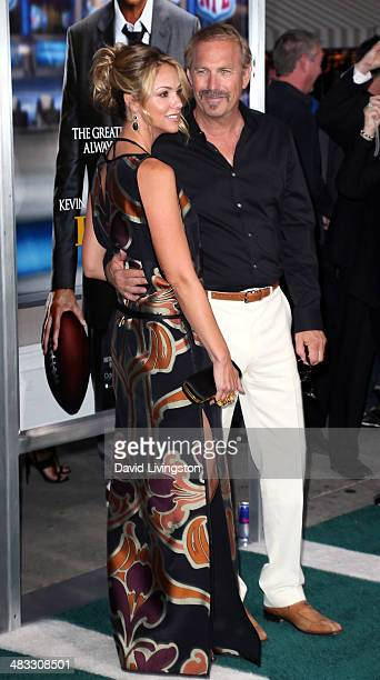Actor Kevin Costner and wife Christine Baumgartner attend the premiere of Summit Entertainment's 'Draft Day' at the Regency Village Theatre on April...
