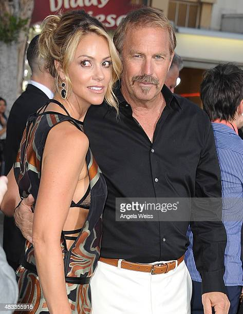 Actor Kevin Costner and wife Christine Baumgartner attend the premiere of Summit Entertainment's 'Draft Day' presented by Bud Light at the Regency...