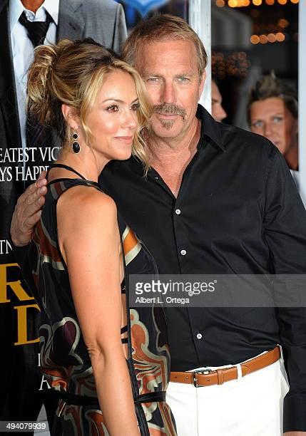 Actor Kevin Costner and wife Christine Baumgartner attend the Premiere Of Summit Entertainment's 'Draft Day' held at Regency Bruin Theatre l on April...