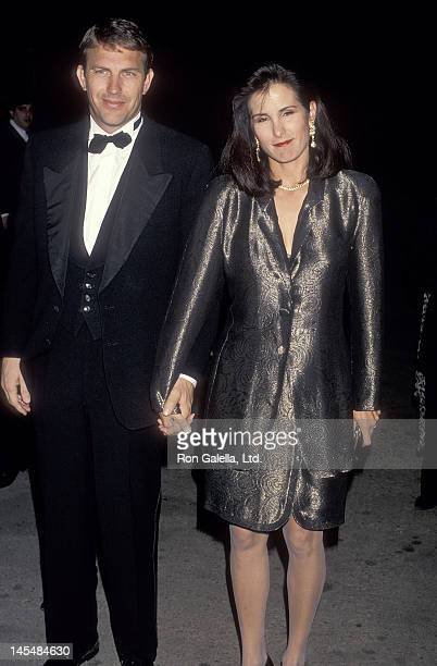 Actor Kevin Costner and wife Cindy Costner attend The Movie Awards on January 30 1991 at Universal Amphitheatre in Universal City California