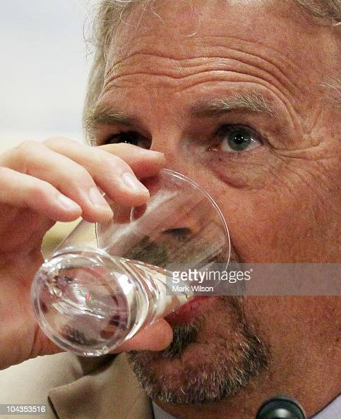 Actor Kevin Costner drinks water as he gives his testimony on the Department of Homeland Security's response to the BP Deepwater Horizon oil spill in...