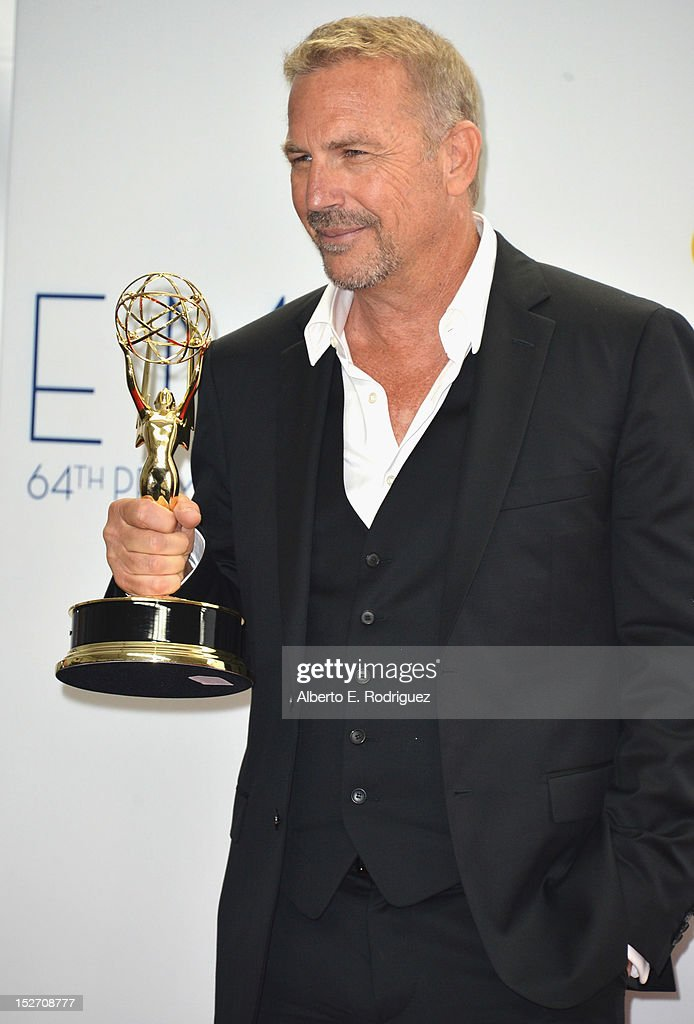 Actor Kevin Costner poses in the 64th Annual Emmy Awards press room at Nokia Theatre L.A. Live on September 23, 2012 in Los Angeles, California.