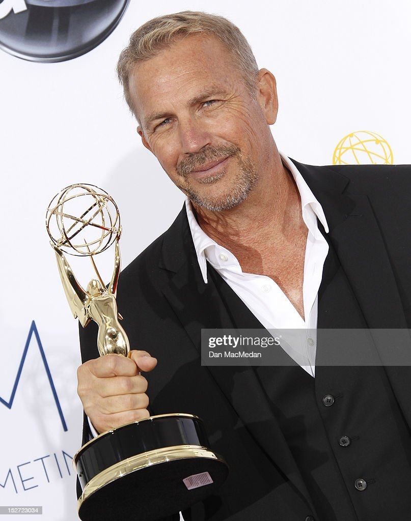 Actor <a gi-track='captionPersonalityLinkClicked' href=/galleries/search?phrase=Kevin+Costner&family=editorial&specificpeople=201719 ng-click='$event.stopPropagation()'>Kevin Costner</a> poses in the press room at the 64th Primetime Emmy Awards held at Nokia Theatre L.A. Live on September 23, 2012 in Los Angeles, California.