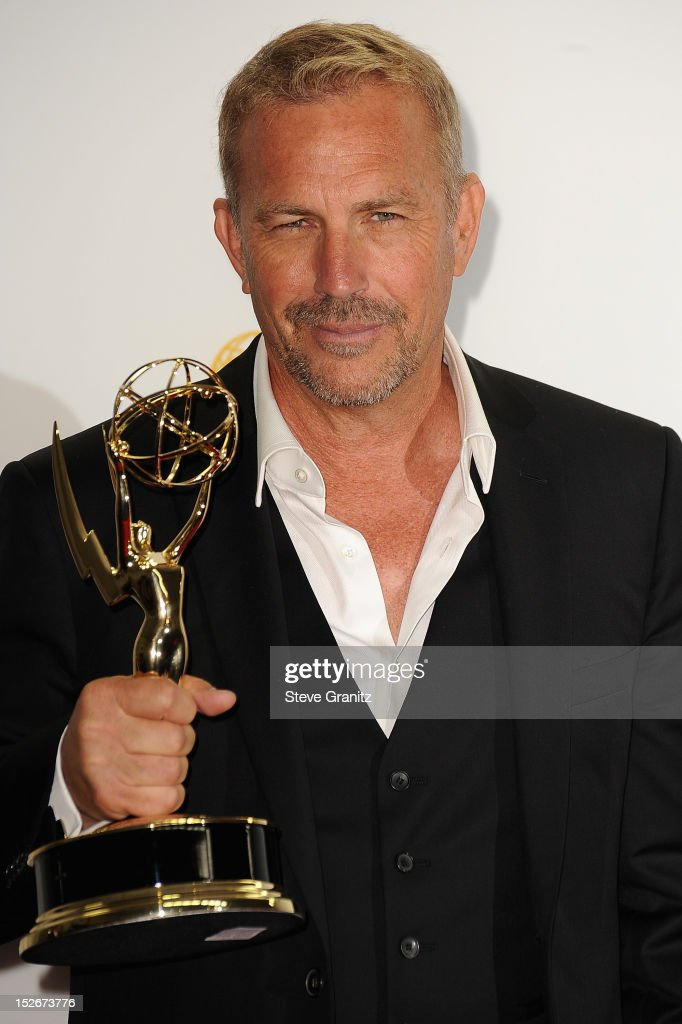 Actor <a gi-track='captionPersonalityLinkClicked' href=/galleries/search?phrase=Kevin+Costner&family=editorial&specificpeople=201719 ng-click='$event.stopPropagation()'>Kevin Costner</a> poses in the press room of the 64th Primetime Emmy Awards at Nokia Theatre L.A. Live on September 23, 2012 in Los Angeles, California.