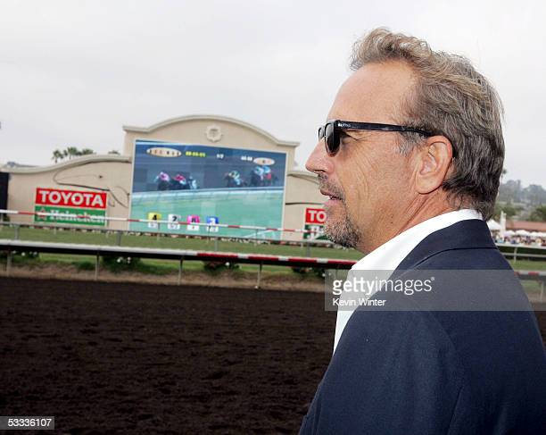 Actor Kevin Costner watches a race at the premiere of 'Laffit All About Winning' a documentary celebrating the life and career of horseracing's...