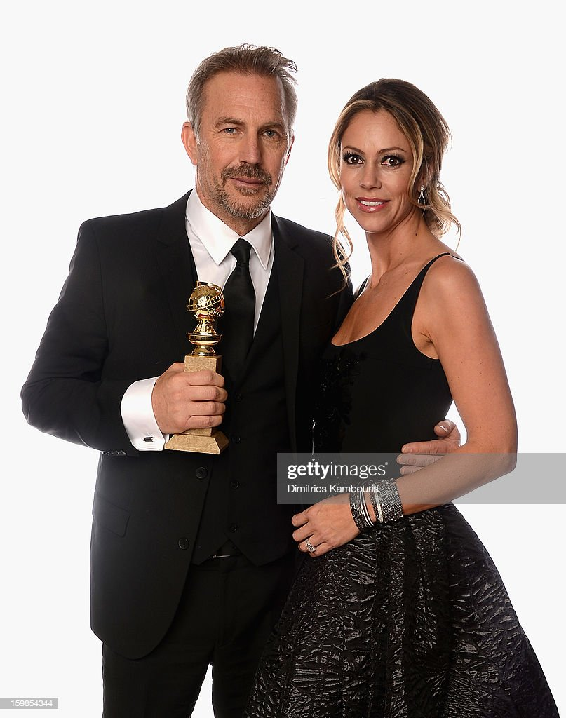 Actor Kevin Costner, winner of Best Actor in a Mini-Series or a Motion Picture Made for Television for 'Hatfields & McCoys', and wife Christine Baumgartner pose for a portrait at the 70th Annual Golden Globe Awards held at The Beverly Hilton Hotel on January 13, 2013 in Beverly Hills, California.