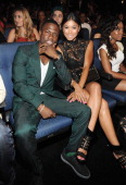 Actor Kevin Hart and Aniko Parrish attend the BET AWARDS '14 at Nokia Theatre LA LIVE on June 29 2014 in Los Angeles California