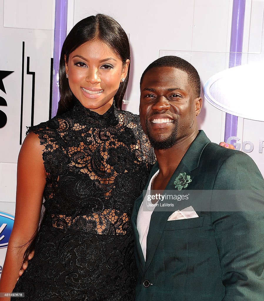 Actor Kevin Hart (R) and Eniko Parrish attend the 2014 BET Awards at Nokia Plaza L.A. LIVE on June 29, 2014 in Los Angeles, California.
