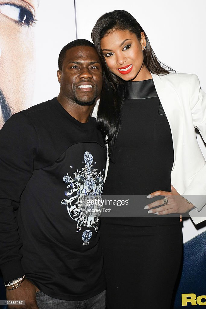 Actor Kevin Hart (L) and Eniko Parrish attend the 'Ride Along' screening at AMC Loews Lincoln Square on January 15, 2014 in New York City.