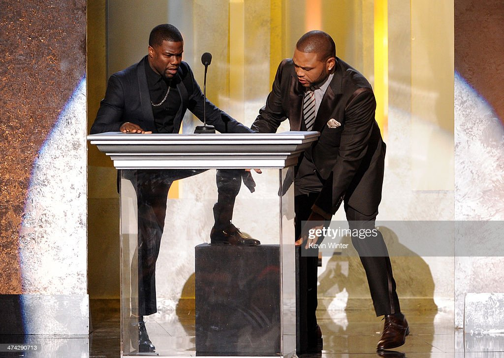 Actor Kevin Hart (L) and host <a gi-track='captionPersonalityLinkClicked' href=/galleries/search?phrase=Anthony+Anderson&family=editorial&specificpeople=202577 ng-click='$event.stopPropagation()'>Anthony Anderson</a> speak onstage during the 45th NAACP Image Awards presented by TV One at Pasadena Civic Auditorium on February 22, 2014 in Pasadena, California.