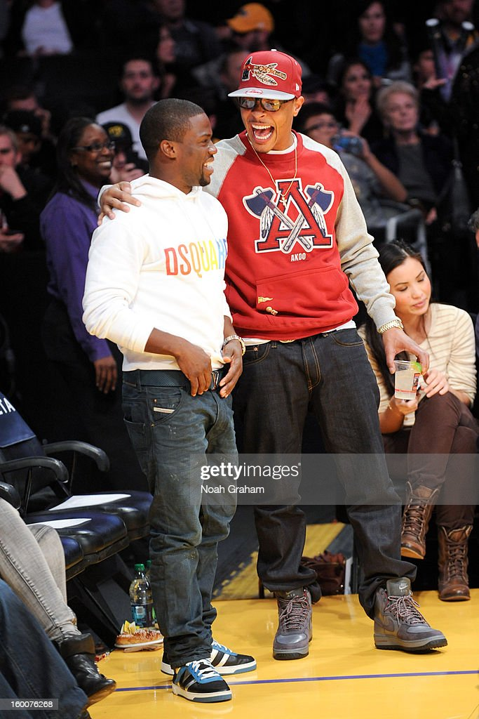Actor Kevin Hart and recording artist T.I. greet each other at halftime of a game between the Utah Jazz and the Los Angeles Lakers at Staples Center on January 25, 2013 in Los Angeles, California.