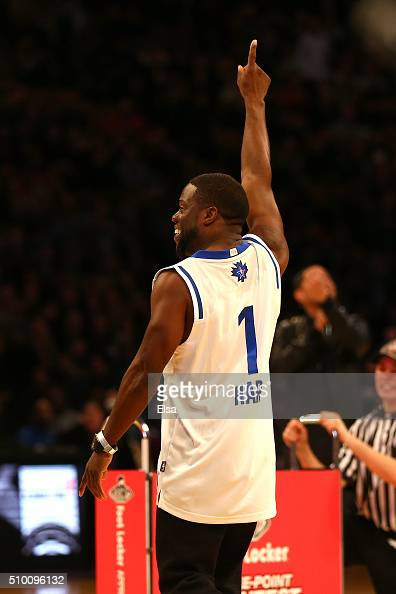 Actor Kevin Hart reacts after making a basket in a three point contest against Draymond Green of the Golden State Warriors before the Foot Locker...