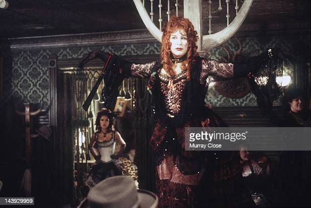 Actor Kevin Kline as Artemus Gordon dressed as showgirl Dora in a scene from the film 'Wild Wild West' 1998 Actress Salma Hayek is visible background...