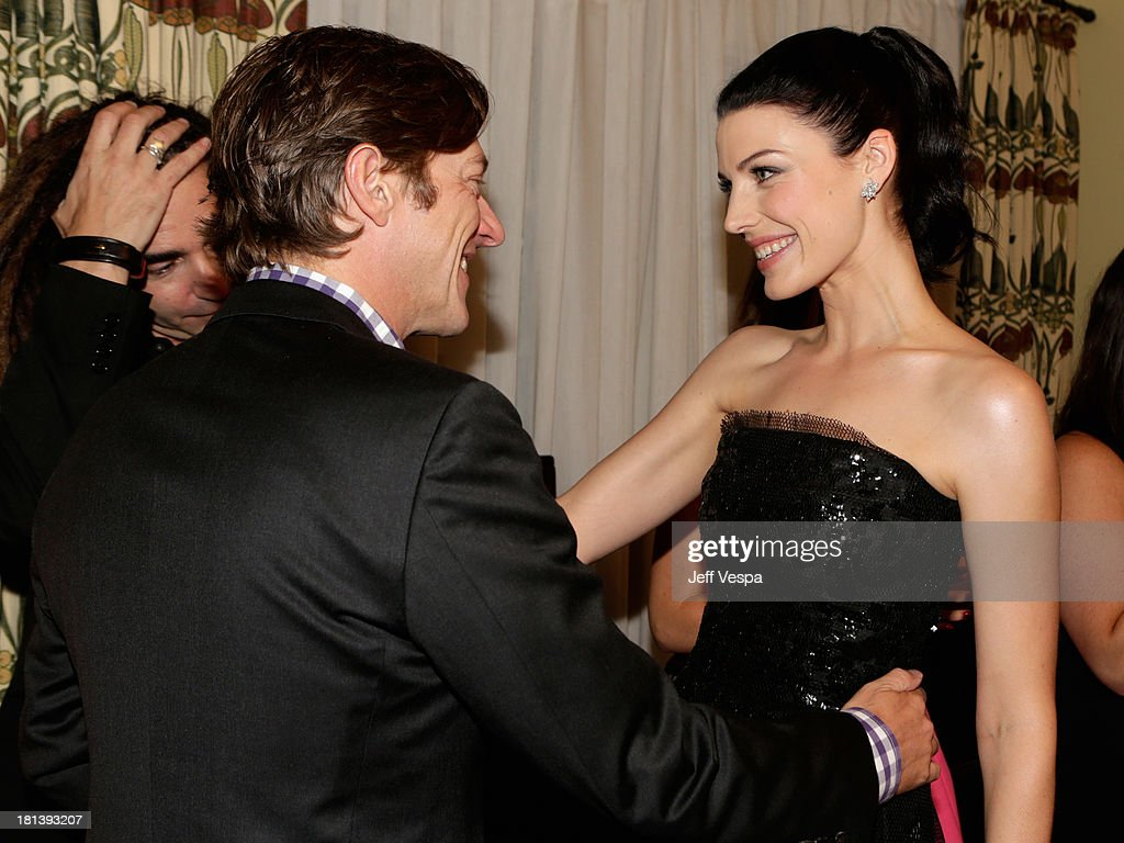 Actor Kevin Rahm (L) and actress Jessica Paré attend Vanity Fair and Maybelline toast to 'Mad Men' at Chateau Marmont on September 20, 2013 in Los Angeles, California.