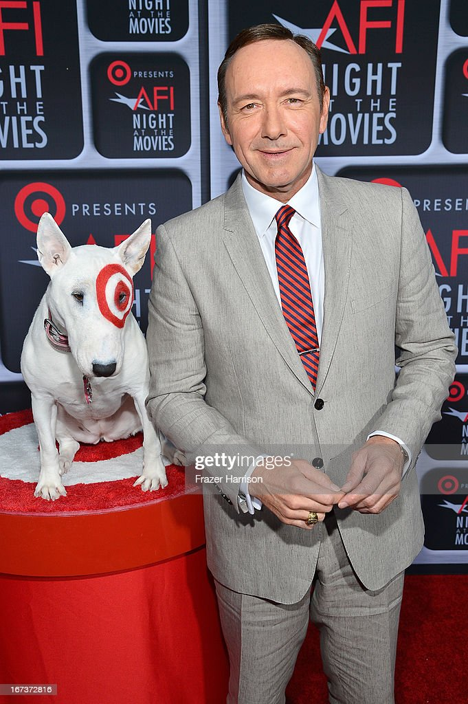 Actor <a gi-track='captionPersonalityLinkClicked' href=/galleries/search?phrase=Kevin+Spacey&family=editorial&specificpeople=202091 ng-click='$event.stopPropagation()'>Kevin Spacey</a> (R) and Bullseye arrive on the red carpet for Target Presents AFI's Night at the Movies at ArcLight Cinemas on April 24, 2013 in Hollywood, California.