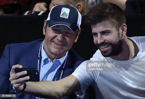 Actor Kevin Spacey and footballer Gerard Pique attend the Singles Final between Novak Djokovic of Serbia and Andy Murray of Great Britain at the O2...